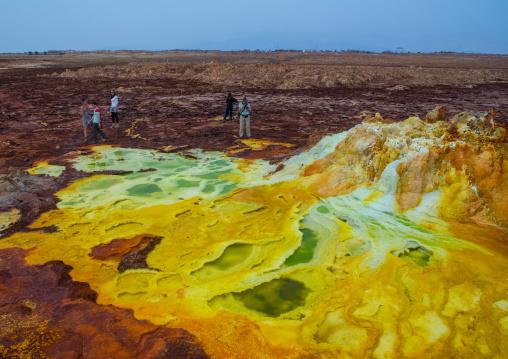 Tourists in the colorful volcanic landscape of dallol in the danakil depression, Afar region, Dallol, Ethiopia