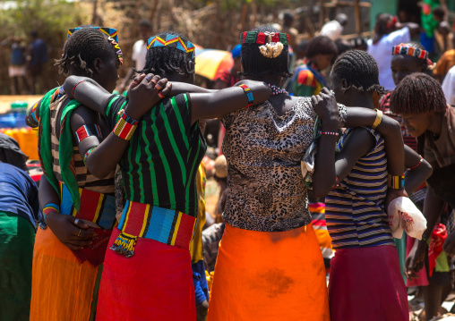Rear view of a group of bana tribe women in a market, Omo valley, Key afer, Ethiopia