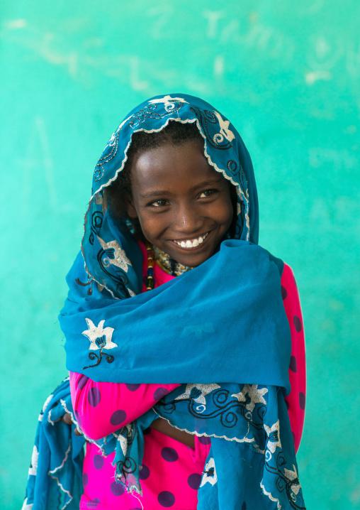 Portrait of a smiling afar tribe girl, Afar region, Semera, Ethiopia