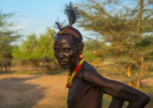 Dassanech elder during dimi ceremony to celebrate circumcision of the teenagers, Omo valley, Omorate, Ethiopia