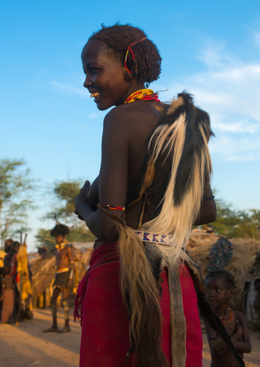 Dassanech tribe woman with colobus monkey skin during dimi ceremony to celebrate circumcision of teenagers, Omo valley, Omorate, Ethiopia