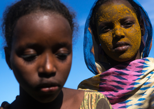 Afar tribe teenage girl with qasil on her face, Afar region, Afambo, Ethiopia