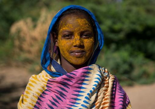 Portrait of an afar tribe teenage girl with qasil on her face, Afar region, Afambo, Ethiopia