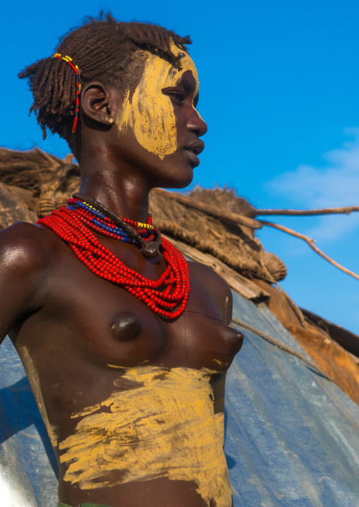 Dassanech tribe teenage girl during dimi ceremony to celebrate circumcision of teenagers, Omo valley, Omorate, Ethiopia