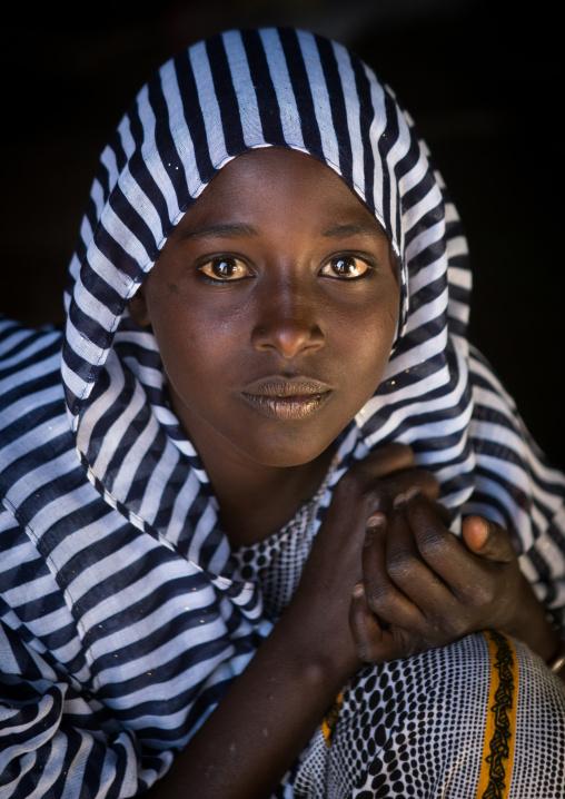 Portrait of an afar tribe teenage girl, Afar region, Afambo, Ethiopia