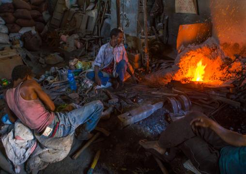 Two blacksmiths in their workshop, Harari region, Harar, Ethiopia