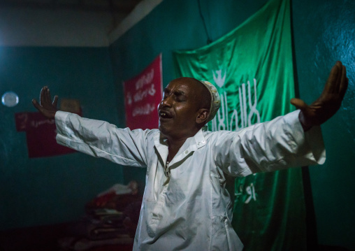 Sufi man goes into a trance during a ceremony, Harari region, Harar, Ethiopia