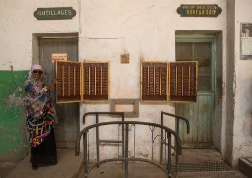 Woman inside the dire dawa train station workshop, Dire dawa region, Dire dawa, Ethiopia