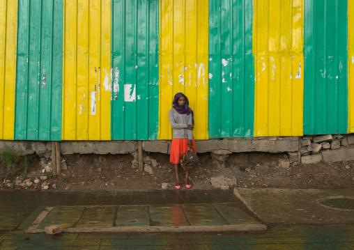Woman looking for shelter under the rain, Addis abeba region, Addis ababa, Ethiopia