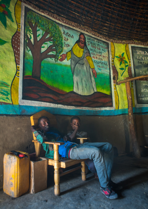 Ethiopia, Kembata, Alaba Kuito, children inside their traditional house with decorated and painted walls