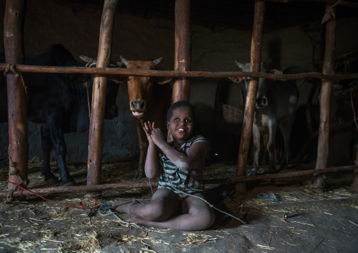 Physically and mentally handicapped child chained to a fence in a house, Kembata, Alaba kuito, Ethiopia