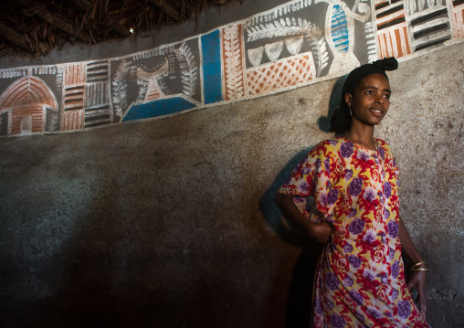 Ethiopia, Kembata, Alaba Kuito, ethiopian woman inside her traditional painted and decorated house