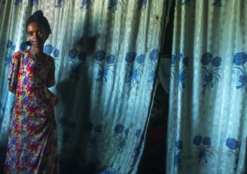 Ethiopia, Kembata, Alaba Kuito, ethiopian woman inside her traditional house