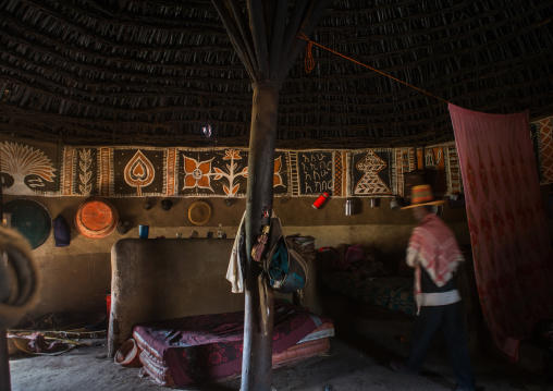 Ethiopia, Kembata, Alaba Kuito, ethiopian muslim man inside his traditional painted and decorated house