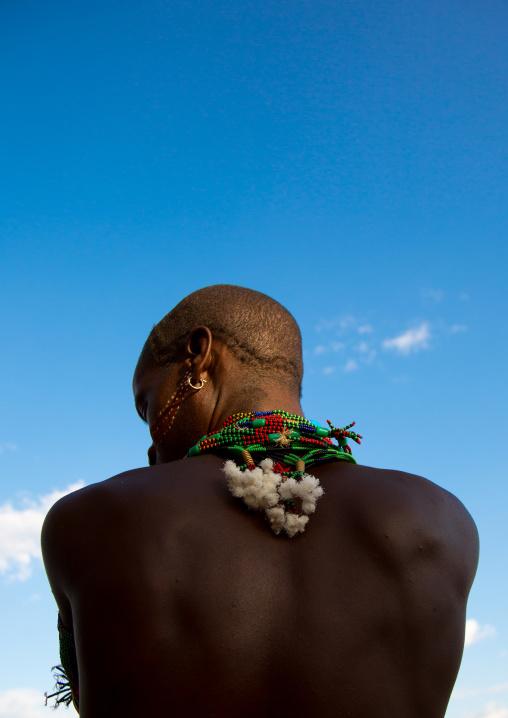 Hamer tribe man attending a bull jumping ceremony, Omo valley, Turmi, Ethiopia