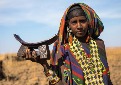 Issa tribe woman with a wooden pillow, Afar region, Yangudi Rassa National Park, Ethiopia