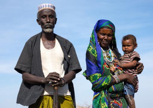 Issa tribe man with his wife and child, Afar region, Yangudi Rassa National Park, Ethiopia