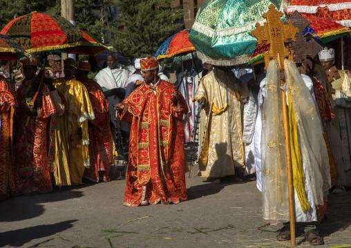 Ethiopian orthodox priests procession celebrating the colorful Timkat epiphany festival, Amhara region, Lalibela, Ethiopia