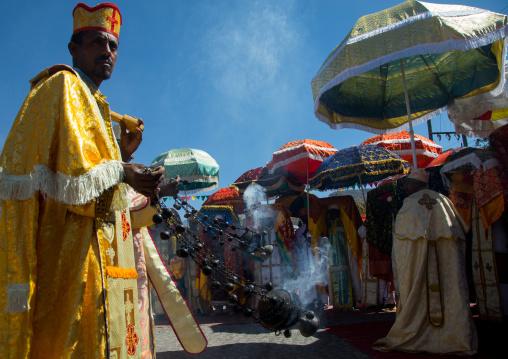 Ethiopian orthodox priests with censers celebrating the colorful Timkat epiphany festival, Amhara region, Lalibela, Ethiopia