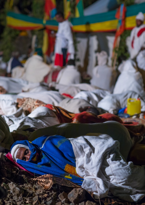 Orthodox pilgrims at Timkat festival during nightime, Amhara region, Lalibela, Ethiopia