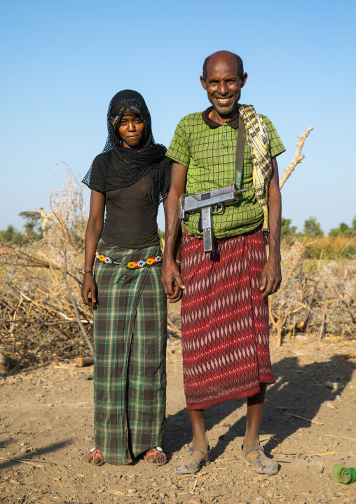 Afar tribe husband with his young second wife, Afar region, Chifra, Ethiopia