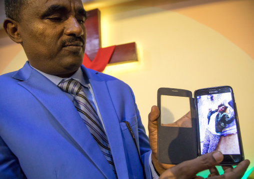 Pastor Kalab Atlabachew in gospel church showing a video of exorcism, Addis Ababa region, Addis Ababa, Ethiopia
