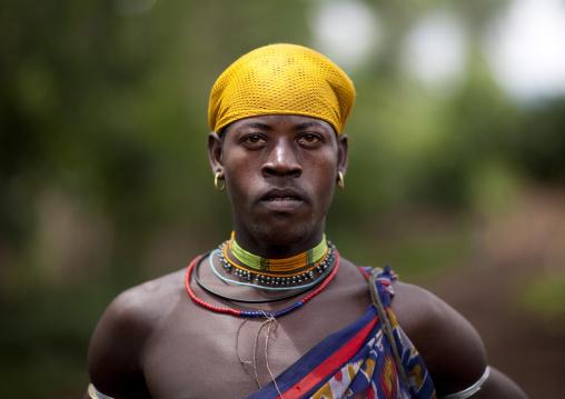 Menit man wearing traditional clothes, Tum market, Omo valley, Ethiopia