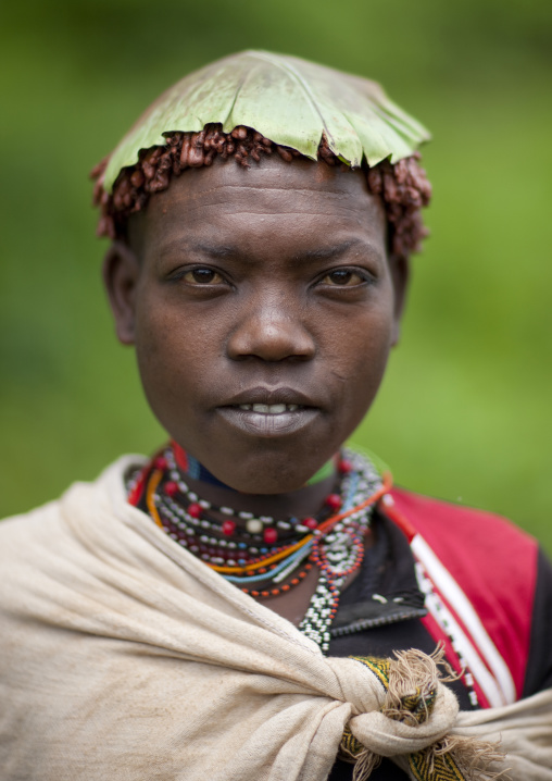 Menit woman with a tree leaf on the head, Tum market, Omo valley, Ethiopia