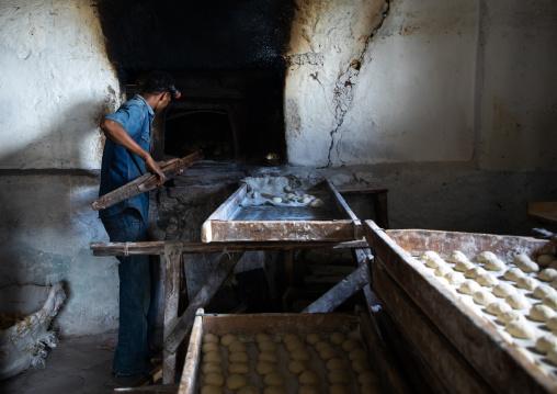 Ethiopian man working in a bakery, Harari region, Harar, Ethiopia