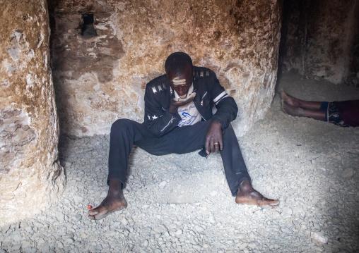 Oromo pilgrim in Sheikh Hussein shrine eating jarawa powder to cure himself, Oromia, Sheik Hussein, Ethiopia