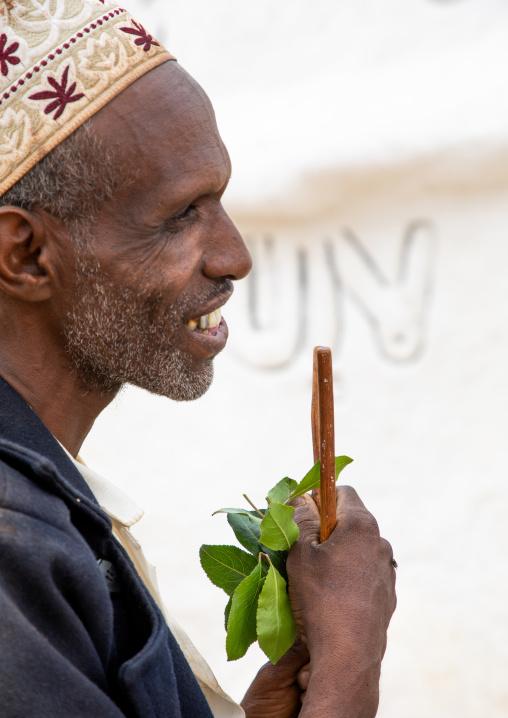 Oromo man with a forked stick in Sheikh Hussein shrine, Oromia, Sheik Hussein, Ethiopia
