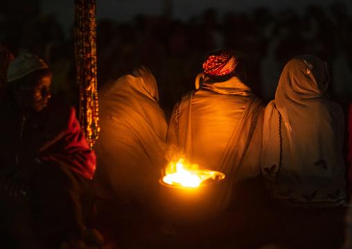Oromo pilgrims praying in the night during the pilgrimage, Oromia, Sheik Hussein, Ethiopia