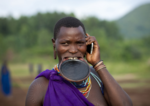 Suri Woman With Lip Plate And Mobile Phone, Turgit Village, Omo Valley, Ethiopia