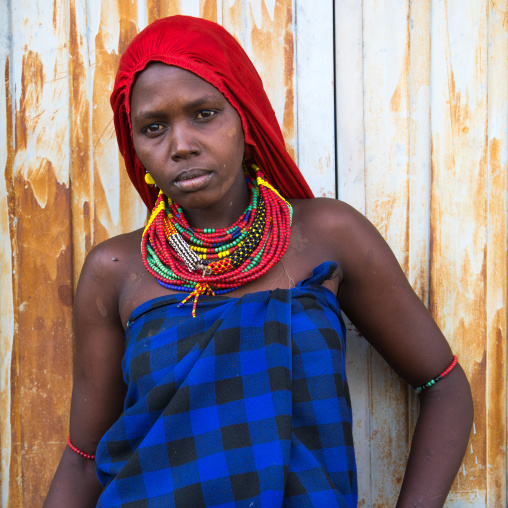 Portrait of a Dassanech woman with a red scarf, Turkana County, Omorate, Ethiopia