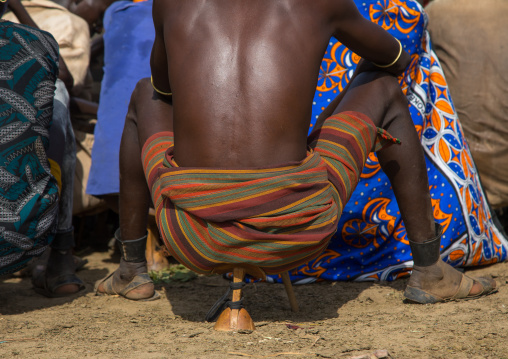 Warrior sit on his wooden seat during the proud ox ceremony in Dassanech tribe, Turkana County, Omorate, Ethiopia