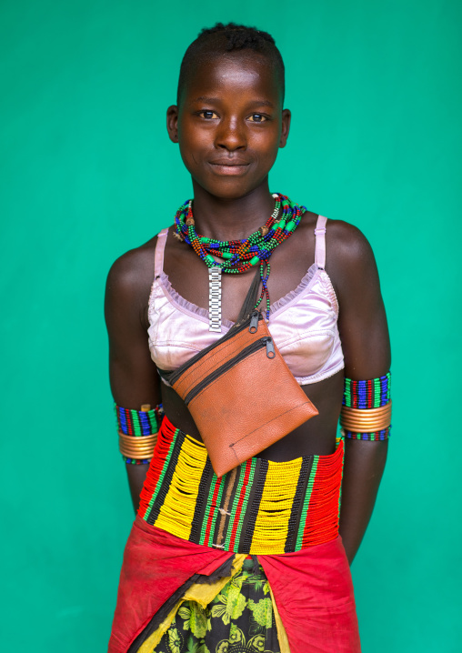 Hamer tribe woman with a bra and a beaded belt, Omo valley, Dimeka, Ethiopia