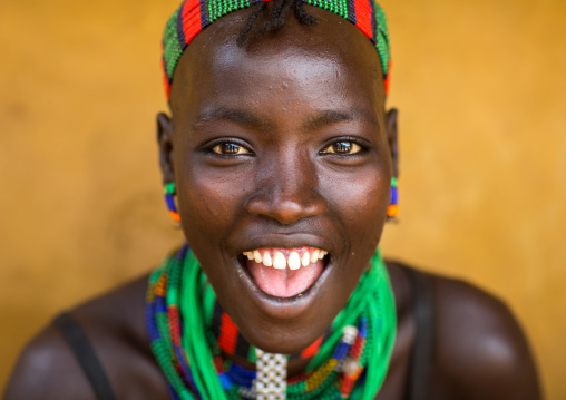 Portrait of a beautiful smiling Hamer tribe woman, Omo valley, Dimeka, Ethiopia