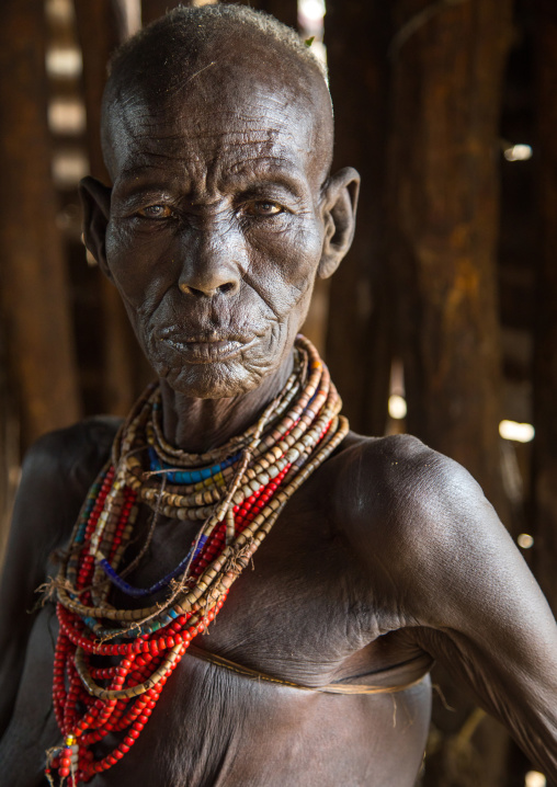 Mrs Moko who had to kill ten children she had before her wedding and who were mingis, Omo valley, Korcho, Ethiopia