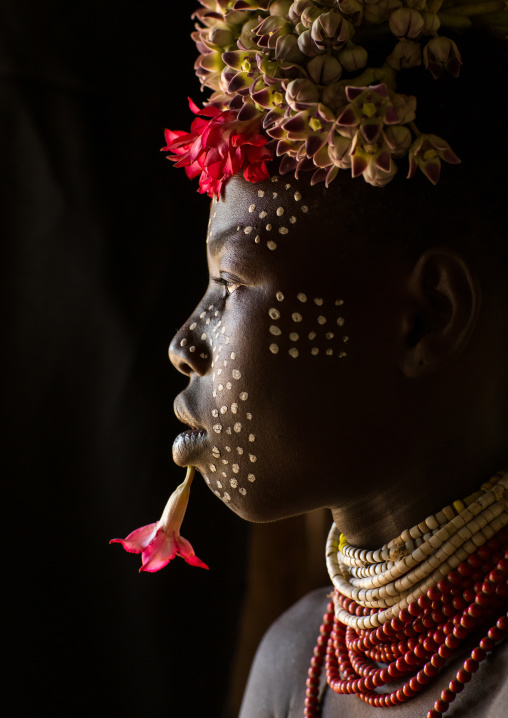 Karo tribe child with flowers decorations, Omo valley, Korcho, Ethiopia