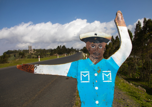 Fake cop mannequin along the road in order to make people respect the speed limit, Gurage Zone, Butajira, Ethiopia
