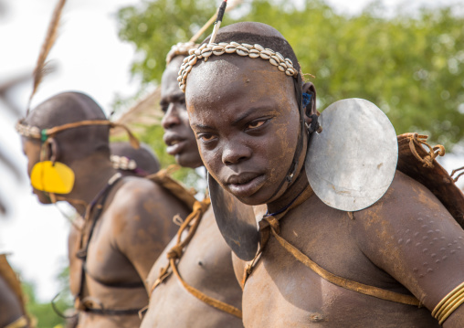 Bodi tribe fat man with giant earrings during Kael ceremony, Omo valley, Hana Mursi, Ethiopia