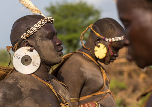 Bodi tribe fat man with cd as earrings during Kael ceremony, Omo valley, Hana Mursi, Ethiopia