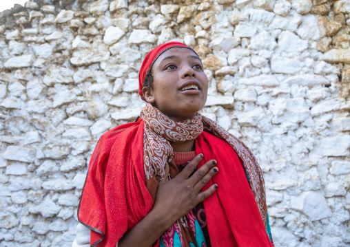 Sufi woman with a red veil into trance during a muslim ceremony, Harari Region, Harar, Ethiopia