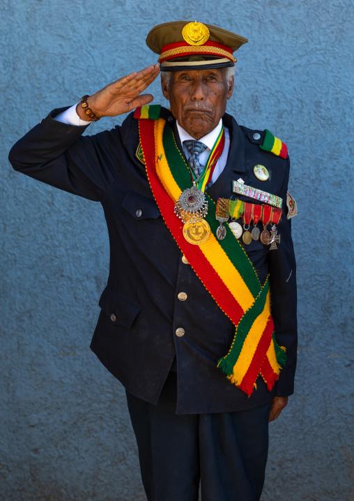 Veteran from the italo-ethiopian war in army uniform saluting, Addis Abeba region, Addis Ababa, Ethiopia