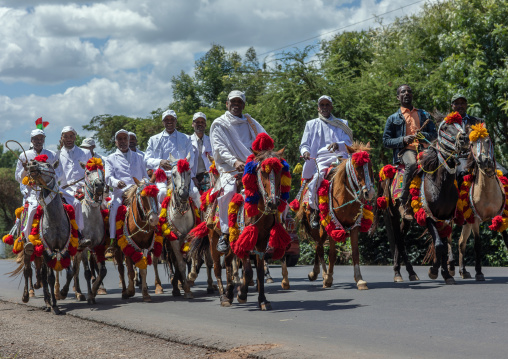 Ethiopian men riding horses on a road during an oromo liberation front party celebration, Oromia, Waliso, Ethiopia