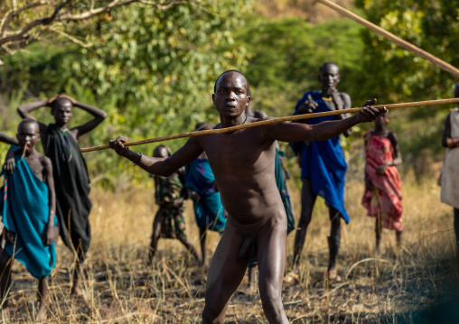 Suri tribe warriors during a donga stick fighting ritual, Omo valley, Kibish, Ethiopia