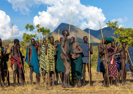 Group of suri tribe warriors during a donga stick fighting ritual, Omo valley, Kibish, Ethiopia