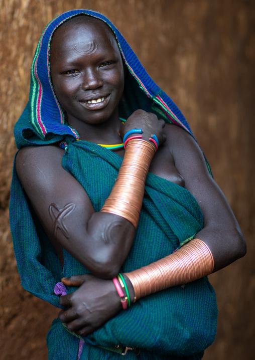 Portrait of a suri tribe woman with impressive bracelets, Omo valley, Kibish, Ethiopia