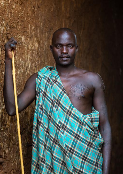 Portrait of a suri tribe man with a stick, Omo valley, Kibish, Ethiopia