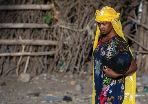 Oromo woman in a market with a yellow scarf, Amhara region, Senbete, Ethiopia